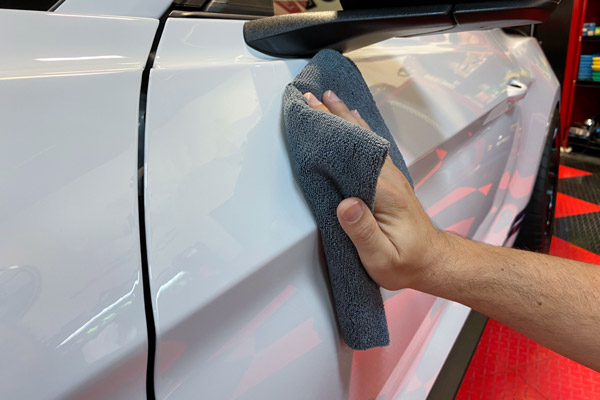 Immediately use a clean and dry microfiber towel to buff the surface.