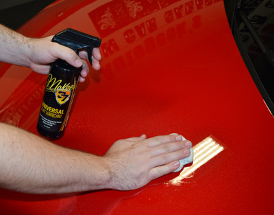 Spray a generous amount of lubricant onto the paint and slide the clay bar back and forth