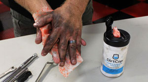 Cleaning hands with DirtCop Hand & Surface Towels