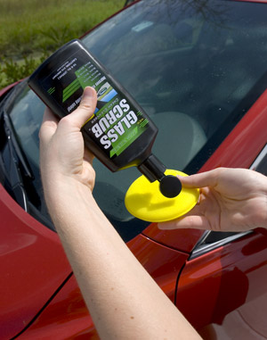 Apply Glass Scrub Glass Stripper using a soft foam applicator. Follow up with Rain Clear Repellent.