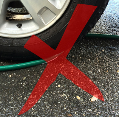 The Hose Slide prevents your hose from getting stuck in your tire!