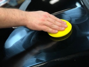 Deep Gloss Paint Sealant being applied to the surface by a foam applicator.
