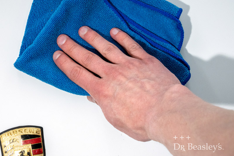 Wipe away excess product with a microfiber towel.