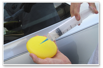 Use isopropyl alcohol to thoroughly clean the car before applying Gloss-Coat.