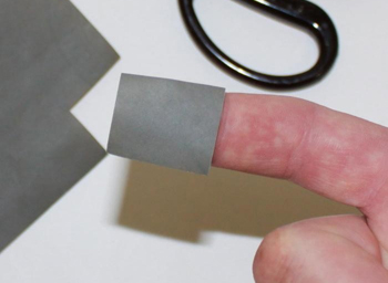 For isolated scratches, you can cut the sandpaper into small pieces.