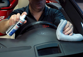 Spray Sonax Dashboard Cleaner onto a soft towel or directly onto the dashboard.
