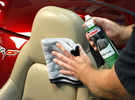 Wipe the leather seat with Sonax Leather Foam, agitating dirty areas.