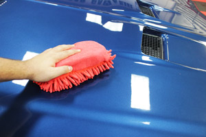 One side of SONAX Microfiber Car Wash Sponge is a sponge.