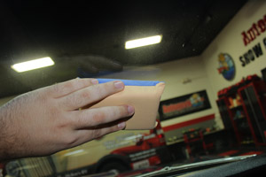 The blue side of the SONAX Windshield Sponge applies a lasting defogger effect
