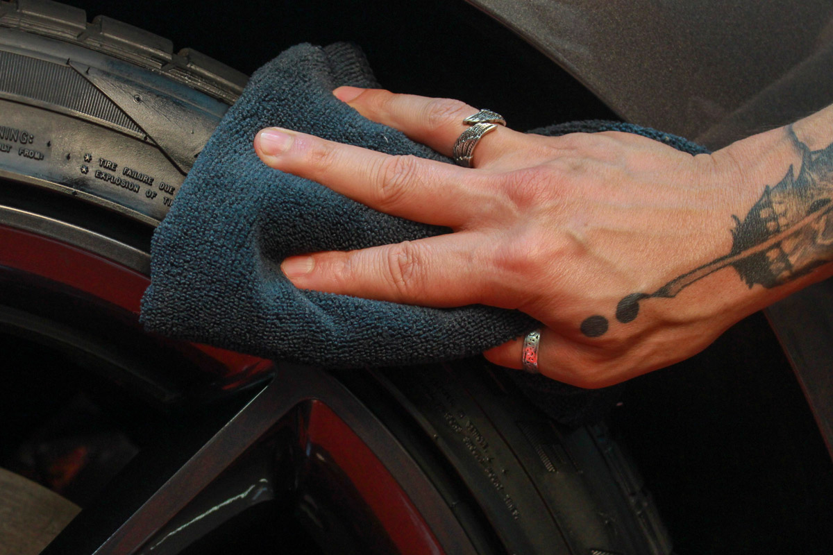 Using a clean microfiber towel, buff any excess DP Tire Coating off the tire's surface.