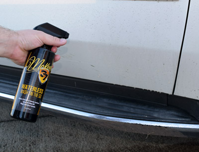 Spray waterless wash directly onto the panel