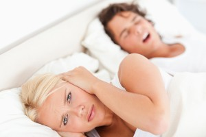 Angry woman awaken by her fiance's snoring