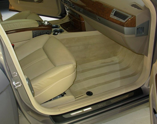 Clean auto carpet with a professional hot water extractor and carpet cleaner.