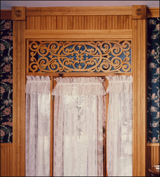 Queen Victorian Fretwork Panel in parlor entry.