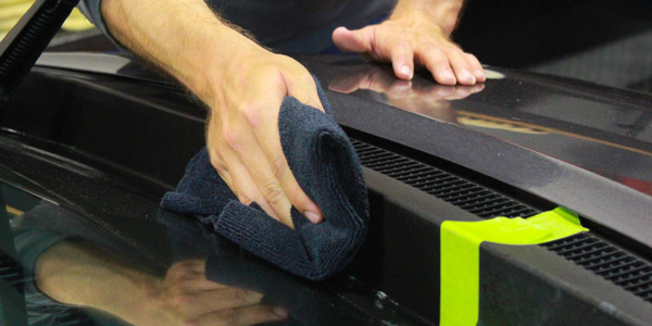 Then we want to buff off any remaining product immediately afterward with a clean and dry microfiber towel.