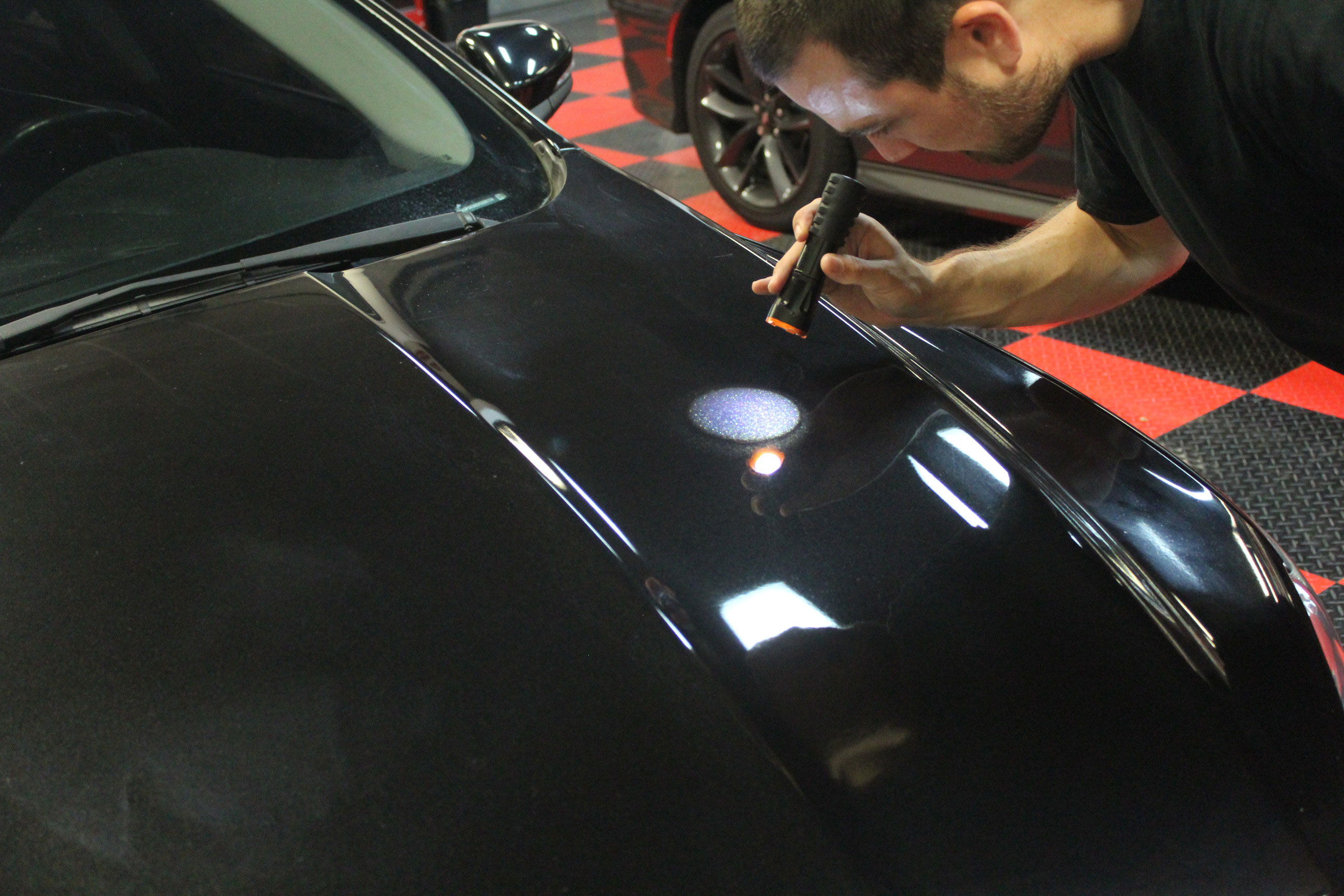 By shining the flashlight on the paint and looking at the perimeter of the on the light, we will be able to get a good view of the severity of the scratches, swirls, and defects in the paint.