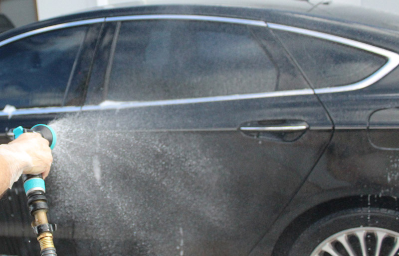 we will rinse off the entirety of the car and make sure there are no more suds or car shampoo on the surface.