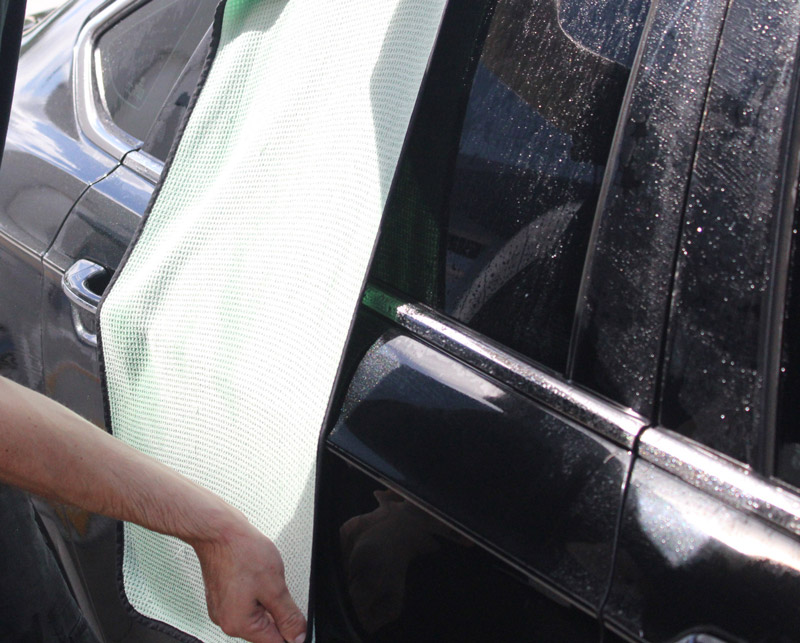 We will use one of our Guzzler towels (which are capable of absorbing up to 7 times their weight in water!) and skim dry the surface by dragging the towel over the surface of the car.