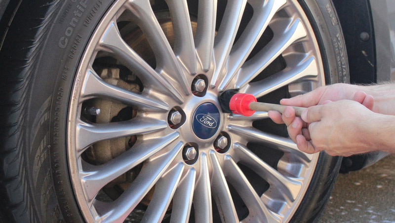 Next up, we will use our Famous Brush to really get into the lug nut recesses and clean everything out of there quickly and easily before moving onto the tires