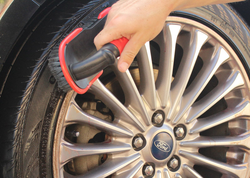 Using the Speed Master Tire Scrub Brush, we are going to agitate the surface of the tires.