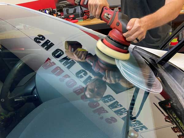 BLACKFIRE Glass Water Spot Remover on a polisher being used on a window