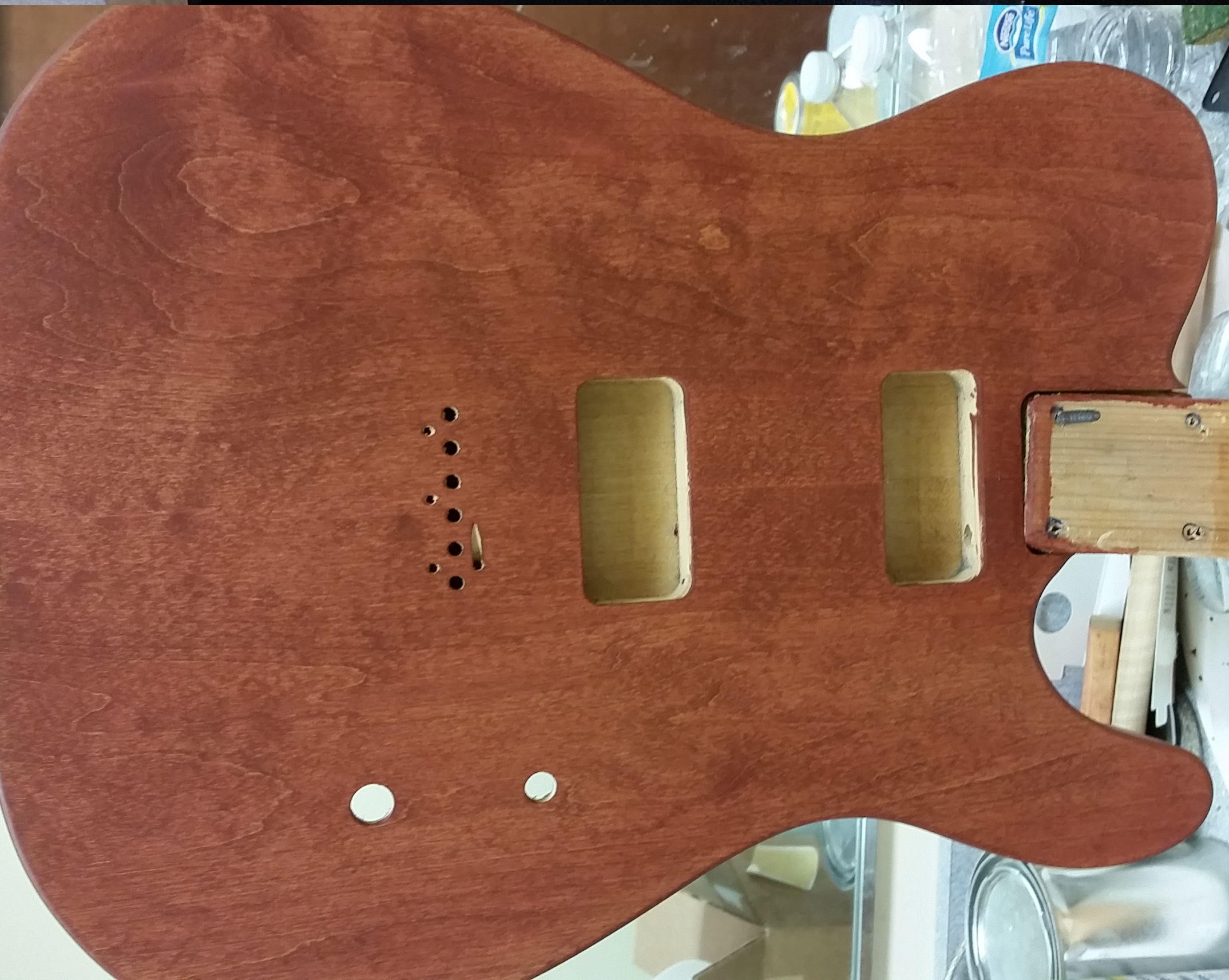 Fender Telecaster Cabronita body by Warmoth, view of front, one coat of red stain, wet