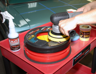 Drying a pad on the Grit Guard Universal Pad Washer on the Universal Detailing Cart.